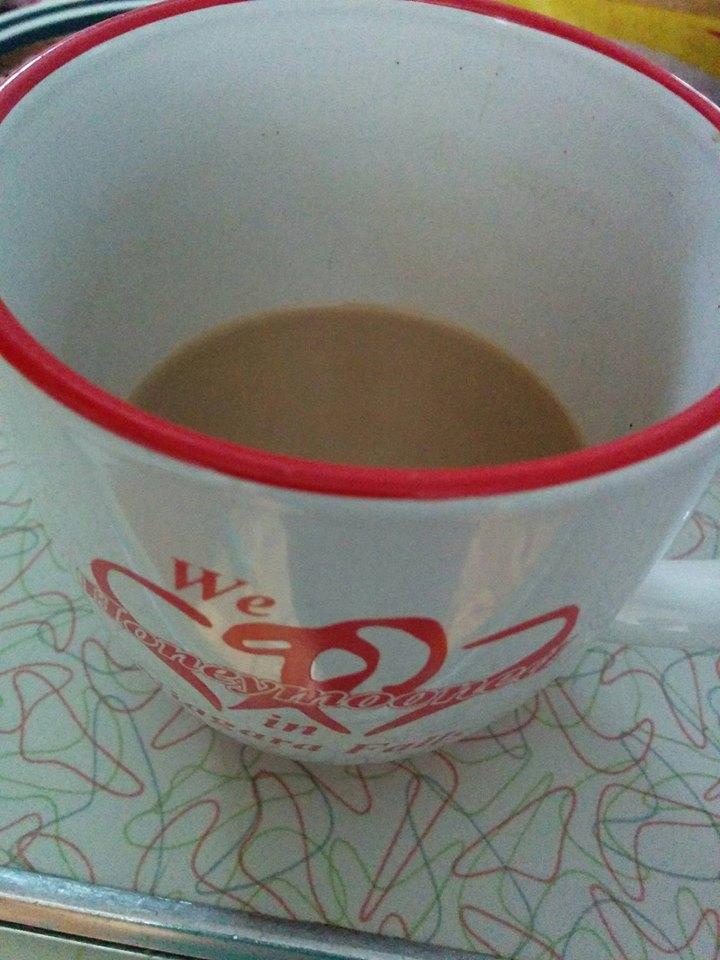 Half full cup of CAFFEINE